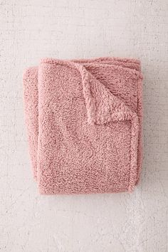 Shop Amped Fleece Pink Throw Blanket at Urban Outfitters today.