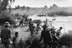 Date unknown Viet Cong meet the enemy face-to-face, most likely in the Mekong Delta or Plain of Reeds. This rare image shows both sides in combat, ARVN soldiers at the top and Viet Cong in the foreground. The VC have flanked the enemy at left and right, which likely meant the ARVN unit was wiped out.