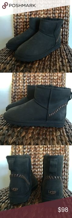 UGG Classic Mini Deco Black Boots Brand New without the box. This Classic Mini Deco boot will give you the stylish kick you need to get through the winter hustle and bustle. Full grain leather upper features moc stitching at the heel for added appeal. Easy slip-on style. UGGpureTM lining for all-day wear. Fully lined with sheepskin or 17mm UGGpureTM wool for additional warmth and comfort. Molded EVA outsole with patent protected tread design for a pleasurable walking experience UGG Shoes…