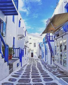 Mykonos, Greece | Charming, colorful side streets are just one of the many quirks that make Mykonos a unique, vibrant paradise destination. Don't miss the pristine beaches that line the Aegean Sea.
