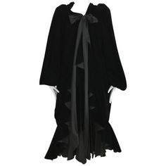Vintage Yves Saint Laurent black  silk velvet evening coat    From a collection of rare vintage day dresses at https://www.1stdibs.com/fashion/clothing/day-dresses/