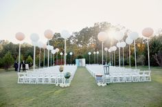 great use of balloons + vintage doors to create this magical setting :)