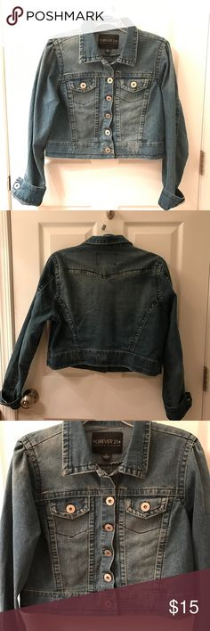 Forever 21 Jean Jacket Fits like a boyfriend jacket. I bought it from Forever 21's Plus Size department because I wanted it to fit that way. It has somewhat of a cropped length to it, but since it's oversized it doesn't actually crop short. Forever 21 Jackets & Coats Jean Jackets