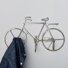 Iconic bicycle wall hook puts the fun in functional. Made from aluminum in a silver finish. 3 hooks hats, bags, jackets and other items. The Company Store Bicycle Decor, Bicycle Shop, Bicycle Art, Bike Wall Hooks, Wall Hanger, Pimp Your Bike, Bike Craft, The Company Store, Bike Accessories