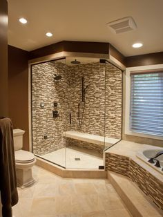 Ultimate shower with tile and bench seat. Love the skinny tiles.