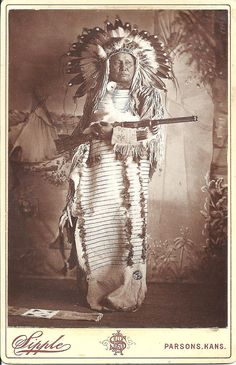 Indian Chief with Winchester cabinet card by A. B. Sipple, Parsons, Kansas. White Bear, a/k/a Tom Frosted, was a chief of the Lower Yanktonais at Standing Rock.