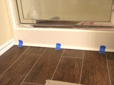 seal between the floor and shower/tub with quarter round ...