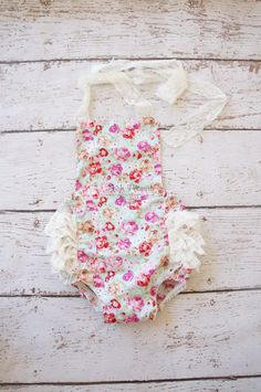 Sooo vintage chic!! Every peanut must have this bubble romper in there closet this summer.  Shabby colored roses with ruffly cream lace bum . Ties