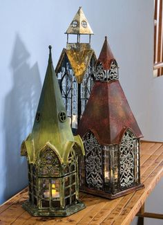 Overview Product Detail Architectural Lanterns Combining design elements from days gone by—fancy metalwork, Gothic arches, beveled glass—these lanterns are romantic and fanciful, like little fairy houses. Lantern Lamp, Candle Lanterns, Fall Lanterns, Candleholders, Garden Lanterns, Fairy Houses, Village Houses, Lamp Light, Sweet Home
