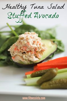 Healthy tuna salad stuffed avocado is the perfect healthy lunch. Packed with protein, produce and a good dose of healthy fat. Get the recipe at fitnessista.com