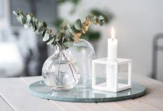 White Kubus, little glass vases and green marble coaster, refreshing still