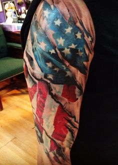 Realistic Ripped Skin Tattoos | ... realistic american flag tattoo on his arm to look as the skin is torn