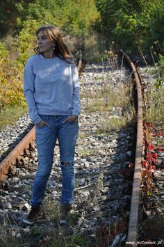 gray blouse and blue jeans