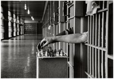 Inmates playing chess from prison cells, Attica Correction Facility, New York, 1972.