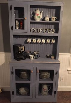 Handmade hutch with black mesh door panels. Finished with Sherwin Williams bracing blue. Lightly distressed. Measures 38 1/2 wide by 78 tall, base is 14 deep.