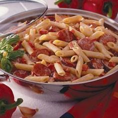 Spicy Sausage Pasta Alfredo with the following substitutions - angel hair pasta and andouille sausage