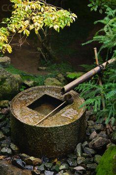 Coin shape Stone Water Basin in Japanese Garden