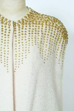 """How to Embellish Garments with Studs (using hot-fix nail heads from KandiCorp) by Judith Neukam on Threads website and in Threads  #154 May 2011, pg 22 """"Cold Shoulder"""". Picture from back of Threads 154, from the Collection at Western Costume Company."""