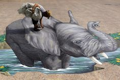 Dutch artist Remko Van Schaik, 45, picks up debris on his 3D elephant art he painted on the ground at a Buddhist temple in Bangkok, Thailand