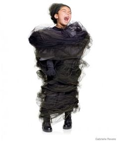 Tornado costume!  Haha!  Great idea!  Could also attach, Dorothy, Toto, Scarecrow, etc.  :)  Tornado - but I'd make it grey with cows and vehicles attached!