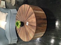 round wood coffee table - can you make it into a storage piece by taking off the top?  a project for Matt!