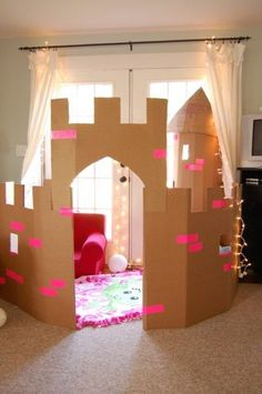 25 DIY Forts to Build With Your Kids This Summer More from my site Learn how to create a DIY cardboard castle for kids. With these free printable resources, you and your children can build a cardboard castle. Free DIY Cardboard Castle for Kids Cardboard Box Crafts, Cardboard Castle, Cardboard Playhouse, Cardboard Box Ideas For Kids, Cardboard Box Houses, Cardboard Furniture, Cardboard Tubes, Playhouse Furniture, Diy Fort