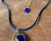 Blue India. Electric Blue suede adorns a vintage pendant.