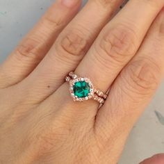 This stunningly unique wedding ring bridal set features a vintage floral engagement ring with a 6x6mm cushion cut conflict free cultured emerald set in a solid 14k rose gold floral setting. To complete the gorgeous look, matching scalloped diamond wedding band is created to be paired with the gorgeous green emerald ring! ** Engagement Ring only: https://www.etsy.com/listing/492222580/vintage-floral-emerald-engagement-ring ** Wedding Ring only: https://www.e...