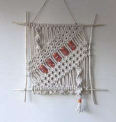 "Hand made macramé wall hanging. Made from cotton rope (3/16""). Choose your beads! Choose from a verity of 2"" colored fabric beads (5). If you don't"