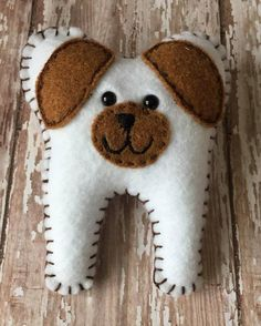 ****Please read this before making your purchase**** This is a HANDMADE puppy dog tooth fairy pillow. I designed this cute tooth shaped puppy dog by myself. I know the tooth fairy loves this pillow because it is very cute and has a nice pocket to leave the treasure! I sew each