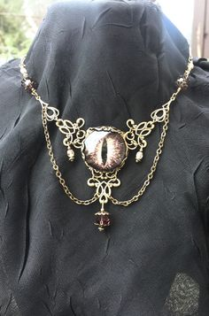 Gold/Brass Purple Dragon Eye Necklace by AestheticAmbrosia on Etsy https://www.etsy.com/listing/259784915/goldbrass-purple-dragon-eye-necklace