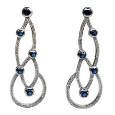 Sapphire Diamond Earrings | From a unique collection of vintage more earrings at http://www.1stdibs.com/jewelry/earrings/more-earrings/