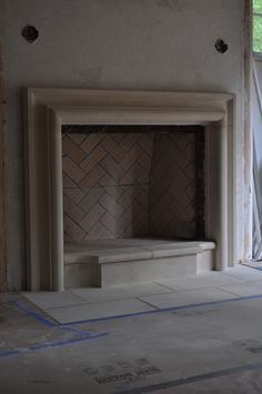 Cast stone mantle surround with internal raised hearth (design and image via stonecrafters.com)