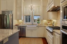 Granite counter tops and farmhouse sink.