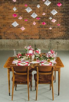 Modern geometric Valentine's wedding decor - hanging pink and white paper geometric garlands and pink and white florals