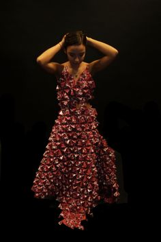 I designed and made a dress using paper origami, using a pattern I created from an image I took in Paris of the clock in Musee D'Orsay.