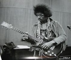 Jimi Hendrix playing a rare lefty protype Black Widow made way back in the day by the Acoustic company.