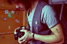 uhmm... cute hipster man with beard. camera. AND tattoo!  ...and vest