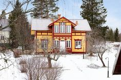 Yellow and falu red house