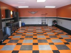 Harley Davidson Garage - eclectic - garage and shed - other metro - by Custom Storage Solutions