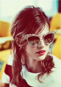 These shades, that simple hair style, and a fun outfit would make for the perfect fashion statement