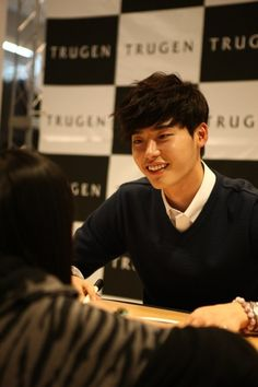 Lee Jong Suk gets close with fans during his autograph session for 'Trugen'