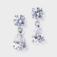 These classic cubic zirconia drop earrings feature a 1.0 carat brilliant round top with a 2.0 carat pear drop. An approximate 6.0 total carat weight. These high quality cubic zirconia earrings measure 3/4th of an inch long. Set in 14k white gold, also available in 14k yellow gold via special order. Cubic zirconia weights refer to equivalent diamond carat size.