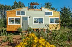This rustic, whimsical tiny house was built by Tiny Heirloom for an entrepreneur in Bend, Oregon. The creative workspace includes a rooftop deck.
