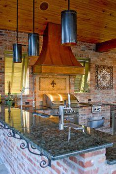 Brick wall, beams, oven hood, lighting