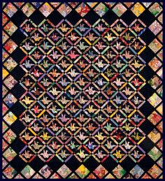 An ancient Japanese legend promises that anyone who folds a thousand origami cranes will be granted a wish. The Peace Quilt, 63 x 70, feat...