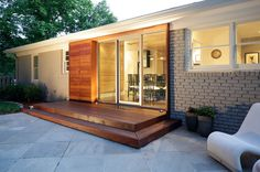 modern exterior by Hagan Architects, Inc.  Wood box ....Camouflage for old back door