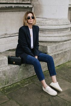 Emma Hill wears dark wash levis 501 jeans, navy check blazer, white t shirt, gold necklaces, ray ban round sunglasses, vintage chanel bag, saint laurent trainers, chic casual outfit