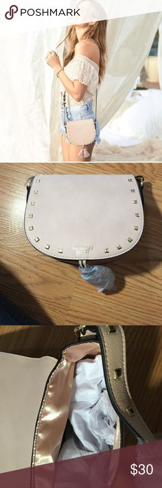 Victoria secret cross body purse It is a light pink almost nude colored purse with gold detailing. It will match almost any outfit Victoria's Secret Bags Crossbody Bags