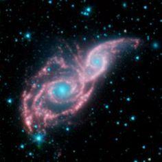 NASA - Galaxies Don Mask of Stars in New Spitzer Image